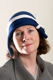 Brunette in blue and white cloche hat Stock Images