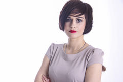 Brunette with bob in beige dress Royalty Free Stock Photos