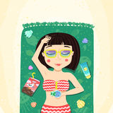 Brunette bob hairstyle summer girl sunbathes on the beach. (on towel with book, glass and sunblock Royalty Free Stock Photography
