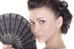 Brunette bonito com ventilador Fotos de Stock