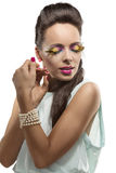 Brunette bonito con maquillaje emplumado Fotos de archivo libres de regalías