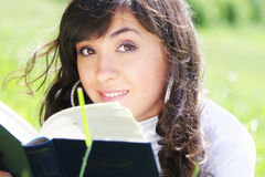 Brunette with book Stock Photo