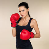 Brunette boxing girl Stock Photos