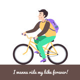 Brunette boy on the green bike. Royalty Free Stock Images