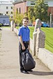 Brunette boy with school backpack. In summer royalty free stock photography
