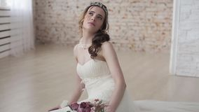 Brunette bride in fashion white wedding dress with makeup stock footage