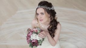 Brunette bride in fashion white wedding dress with makeup stock video footage
