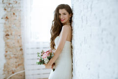 Brunette bride in fashion white wedding dress with makeup Stock Photos
