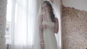 Brunette bride in fashion white wedding dress with makeup stock video