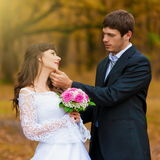 Brunette bride and groom  autumn background Stock Photo