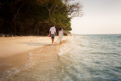 Brunette bride and groom walk barefoot Royalty Free Stock Photos