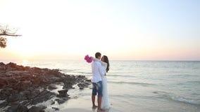 Brunette bride and handsome groom barefoot hug stock video footage