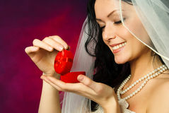 Brunette bride looking at the wedding ring Stock Photos