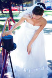 Brunette bride in the park Royalty Free Stock Photo