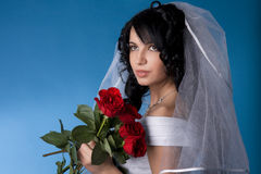 Brunette bride with red roses Royalty Free Stock Photos