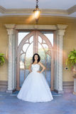 Brunette bride in a white dress on the wedding day. Brunette bride in a white dress Stock Photos