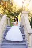 Brunette bride in a white dress on the wedding day. Brunette bride in a white dress Royalty Free Stock Photography