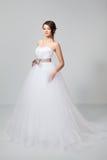 Brunette bride in white wedding dress. Beautiful brunette bride in white wedding dress, in studio Stock Photo