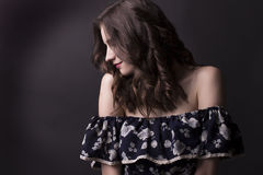 Brunette brunette woman with naked shoulders. Tender young  woman with naked shoulders Royalty Free Stock Photos