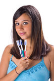 Brunette with brush teeth Stock Image