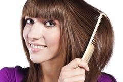 Brunette brushing her hair, in studio Stock Images