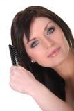 Brunette brushing her hair Stock Photo