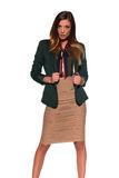 Brunette in business attire. Tall slim brunette dressed in green and tan Stock Photography