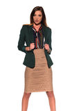 Brunette in business attire. Tall slim brunette dressed in green and tan Royalty Free Stock Photography