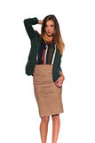 Brunette in business attire. Tall slim brunette dressed in green and tan Stock Photos