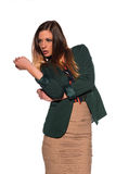 Brunette in business attire. Tall slim brunette dressed in green and tan Stock Image