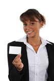 Brunette with business card Stock Photos