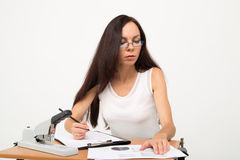 Brunette business lady look at papers. Woman reading docs and marks some numbers Stock Photos