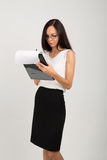 Brunette business lady with paper clip board Stock Photo