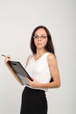 Brunette business lady with paper clip board Stock Photography