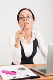 Brunette business lady pointing Royalty Free Stock Photo