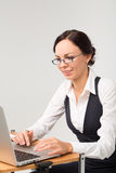 Brunette business lady works on computer Stock Photography