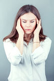 Brunette business woman headache touch head with finger Royalty Free Stock Photos