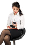 Brunette business woman with mobile phone Stock Photography