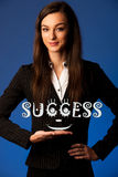 Brunette business woman standing with success word Stock Photos