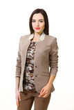 Brunette business woman with straight hair style. Indian business woman with straight hair style in summer gray jacket close up portrait isolated on white stock image