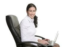 Brunette business woman typing sit laptop Stock Image