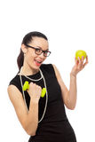 Brunette businesswoman in black dress holding apple and dumbbell Stock Photo