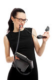 Brunette  businesswoman in black dress holding telephone and tal Royalty Free Stock Photography