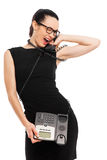 Brunette  businesswoman in black dress holding telephone and tal Stock Images