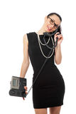 Brunette  businesswoman in black dress holding telephone and tal Royalty Free Stock Image