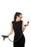 Brunette  businesswoman in black dress holding telephone and tal Royalty Free Stock Images