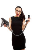 Brunette  businesswoman in black dress holding telephone and tal Stock Photo