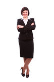 Brunette businesswoman dressed in black suit. Stock Image