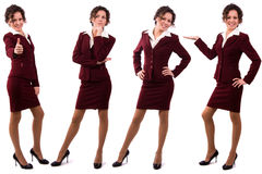 Brunette businesswoman dressed in redk suit. stock photography