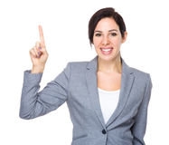 Brunette Businesswoman with finger point up Stock Photos
